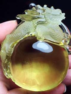 Natural yellow crystal dragon ball pendant.