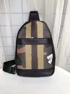 Coach Charles pack with Camo varsity