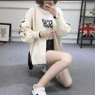 Knitted white cream sweater