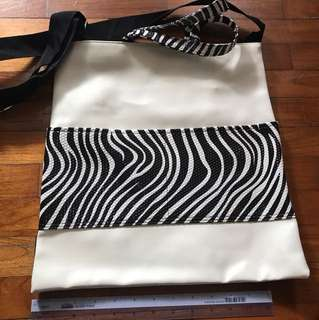 Water proof zebra tote bag sling or hand carry