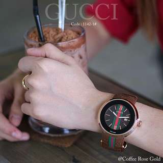 New GUCCI 1142-1#p  Diameter : 4,5cm Quality : Semi Premium Stainless Steel Case Band Material Strap : Rubber Available 3 colours : - Black Black - Black Rosegold - Coffee Rosegold   Active Date New Model Free box Free battery Weight l :
