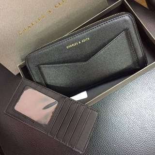 Cnk wallet with extra slot