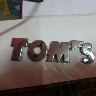 Logo tom's