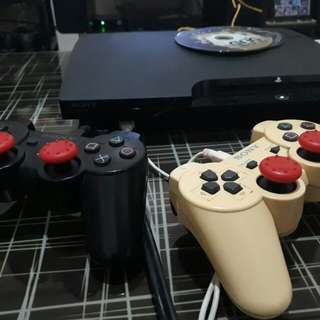 PS3 Slim Black with 5 games