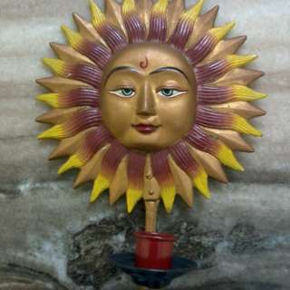 Sun face candle holder