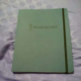 Milken Institute blue journal notebook