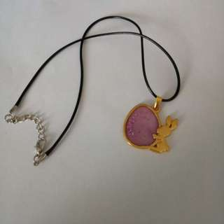 Rabbit with purple egg necklace