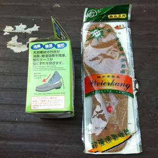 New and unopened shoe insoles and deodorizer.
