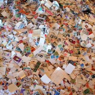 UNSORTED CHEST OF STAMPS