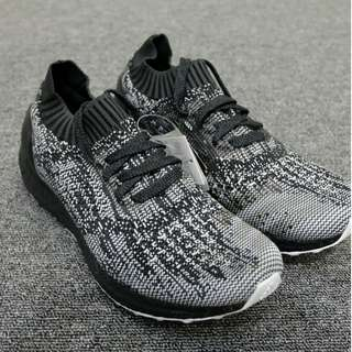 UB UNCAGED BLACK, SILVER AND WHITE