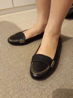 Black closed toe flats