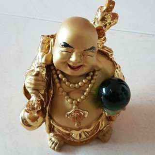 Laughing buddha with crystal ball creamic gold plated