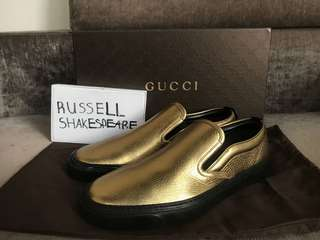 Gold Gucci slip ons