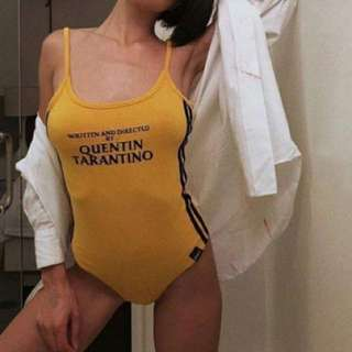 O-Mighty style film by tarantino bodysuit