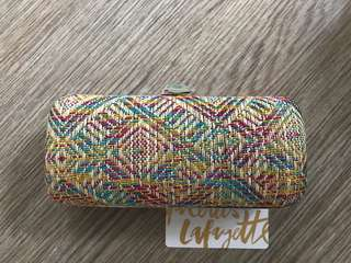 Colorful party clutch (card shown for size comparison)