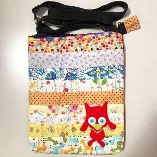 colourful patterned sling bag