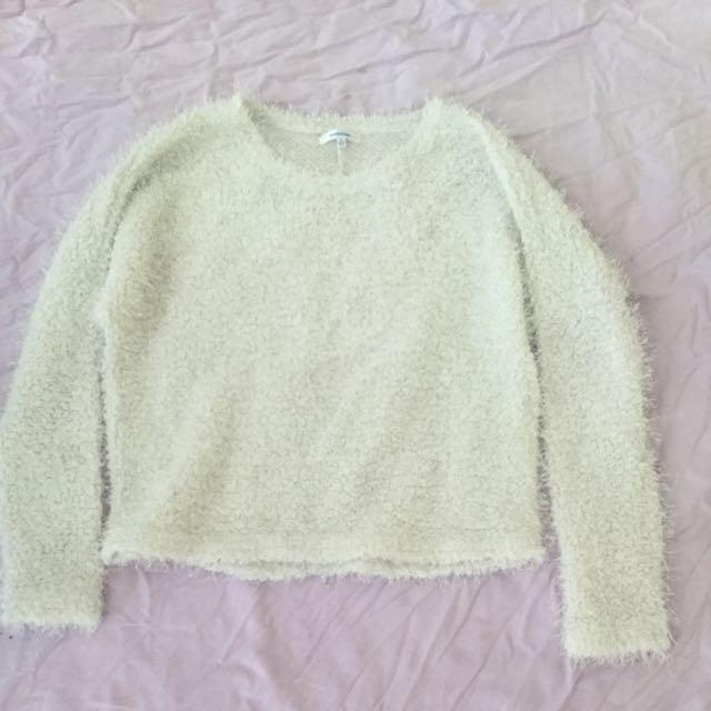 Fluffy white jumper