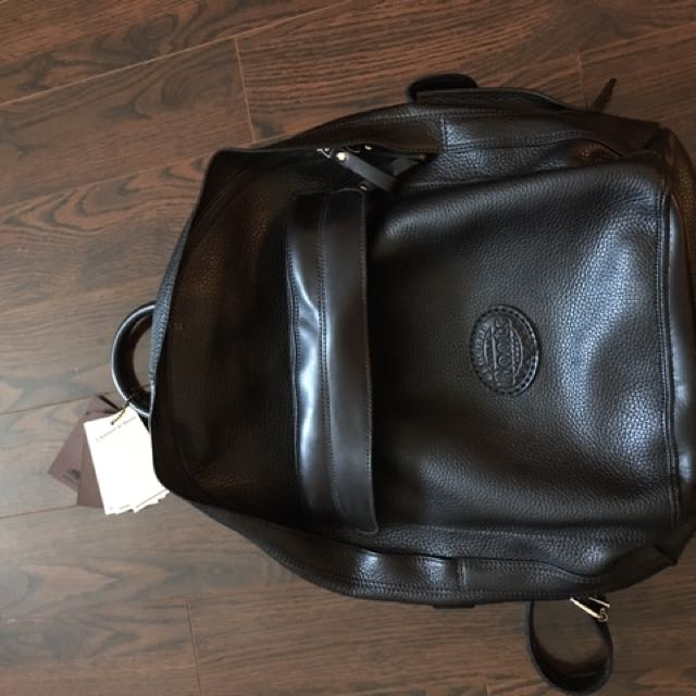 Leather roots backpack