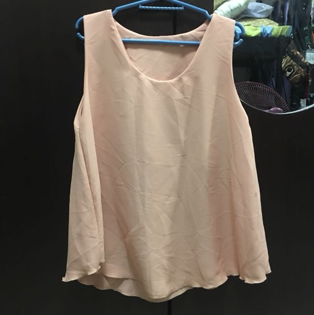 Sleeveless blouse in nude