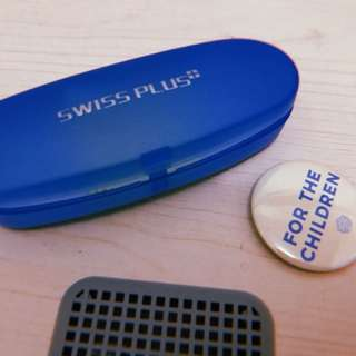 Eyeglass Holder (Swiss Plus) with FREE Unicef Badge