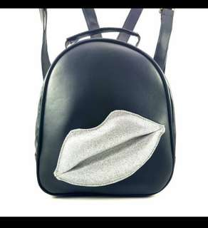 AM backpack lip mini