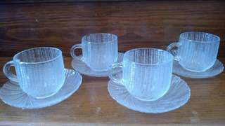 Set of 4 glass cups and saucers