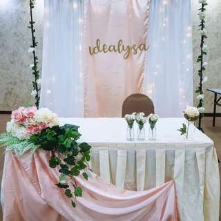 Customised solemnisation table and fairy-lights fabric floral arch backdrop wedding decor