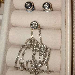 Set earring and necklace with diamonds.