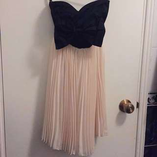 🎀 PAPRIKA strapless pleated dress with bow and sweetheart neckline