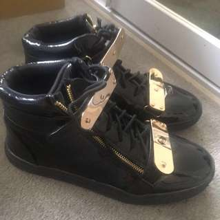 Black and gold sneakers