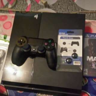 For sale ps4 500gb w/ free 2 disc and coolingfan