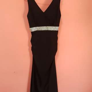 Brand new black evening dress with glittery details at the waist. Great cutting and good material, makes you look glam. MOTHERS DAY PROMO