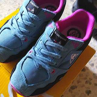 Le coq sportif sport shoes.