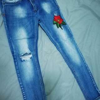 FUBU ripped jeans