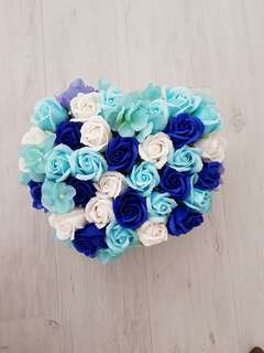 Blue roses fake flower bed