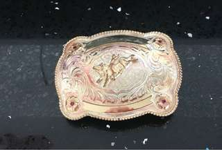 Cowboy silver belt buckle