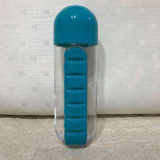 Pill organiser box with water bottle