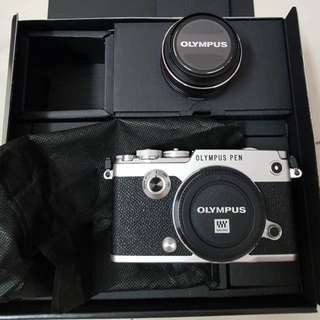 Olympus PEN-F Silver Body c/w 17mm F1.8 lens.