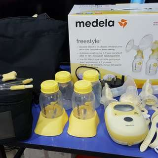 Medela Freestyle Double Pump with hands free accessories (Under warranty)