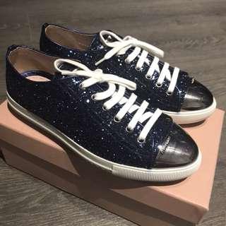 BN Miu Miu sneakers in glitter blue