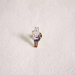 Bunny with Newspaper Enamel Pin