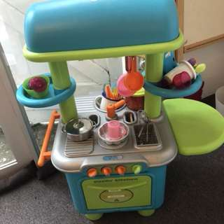 Kids Sizzling Kitchen . Comes with pots, pans, fruits , vegetables, groceries, etc