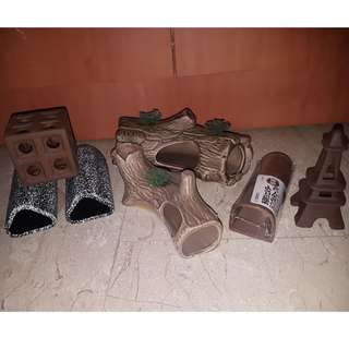 Brand new and assorted pelco caves and ornaments