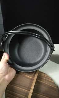 Japanese cast iron casserole with wood cover