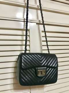 Sling bag with chain strap