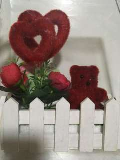 Bear in a fence/ Love and flowers