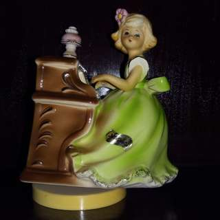 vintage girl play piano music box