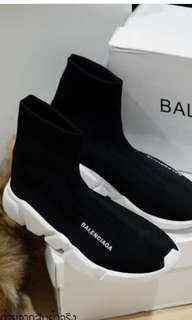 Balenciaga knit sneakers.