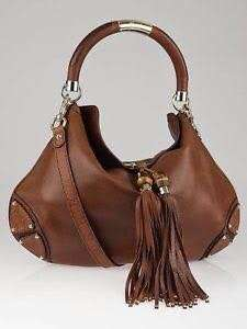 mint condition authentic Gucci Indy hobo brown with tassle leather - comes complete 20 by 15