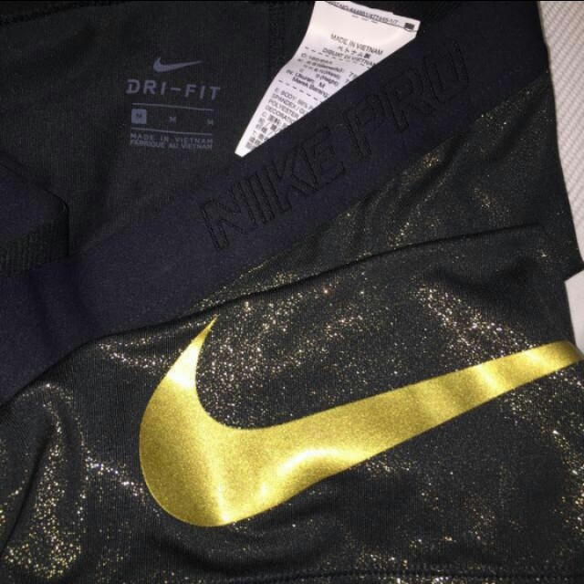 Gold and Black Nike Pros